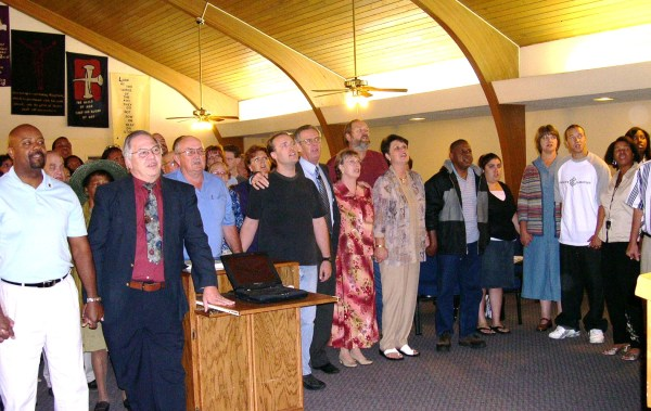 Our California church family gathers around us to sing, pray and wish us well on the Sunday before our move to Virginia, July 2004