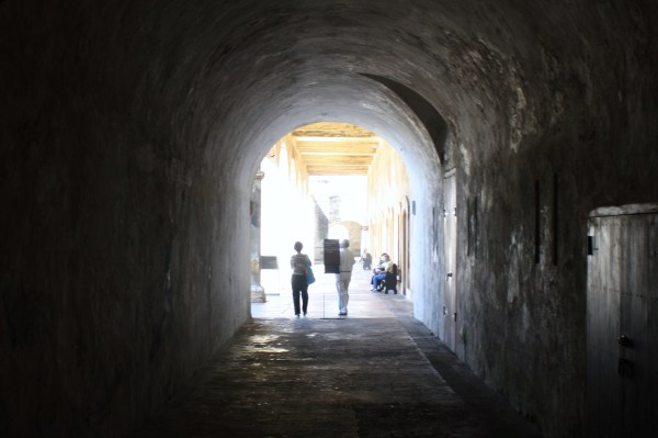Light shines into a dark corridor in Castillo San Cristóbal, San Juan, Puerto Rico 2010