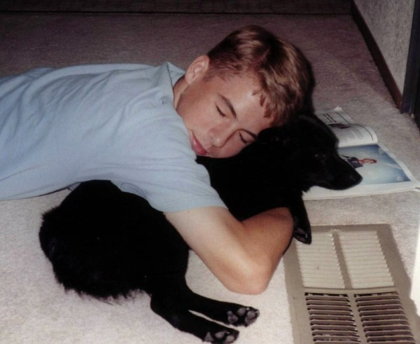 I caught our son dozing with his canine companion, sometime around 2001