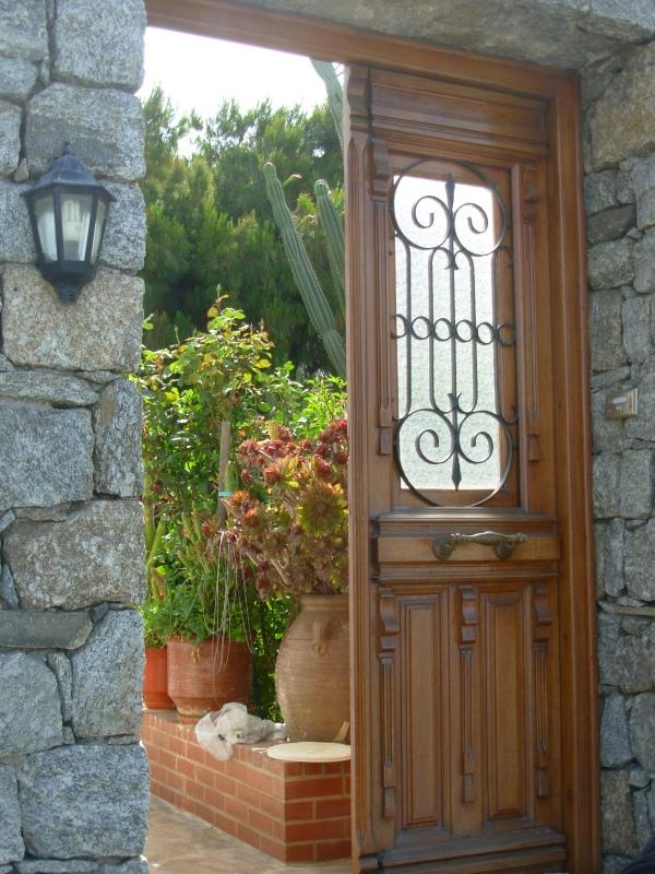 A garden doorway beckons in Mykonos, Greece 2008