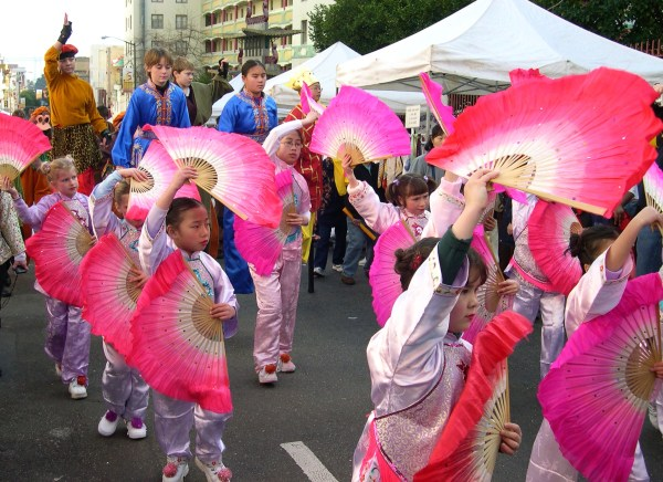 Fan dancers and stilt walkers celebrate Chinese New Year in San Francisco, 2004
