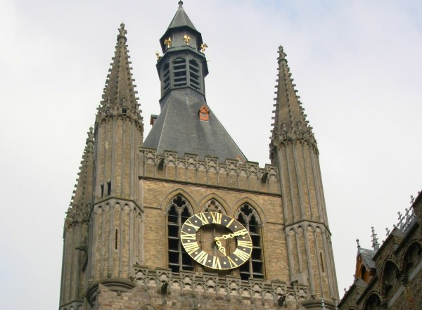 A clock adorns the medieval Lakenhalle (Cloth Hall) in Ypres, Belgium, as seen in March 2007