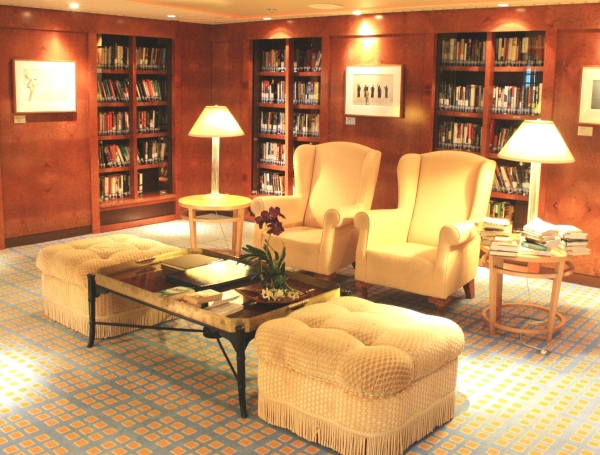 When we sailed on the Celebrity Summit in March 2011, our cabin was two doors down from this lovely little library.