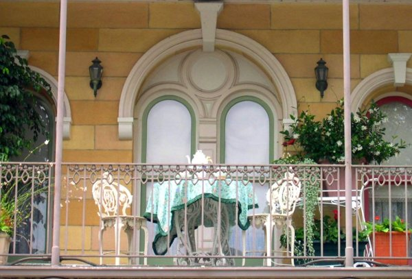 A balcony with an inviting tea table overlooks Disneyland, July 2004