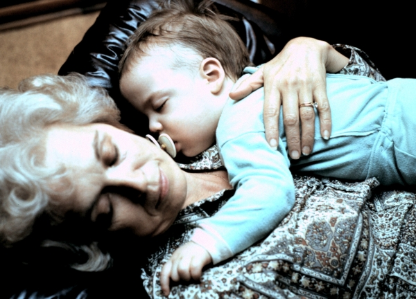 Sleeping like a baby: Mama naps with her first grandchild, Ryan, in 1976
