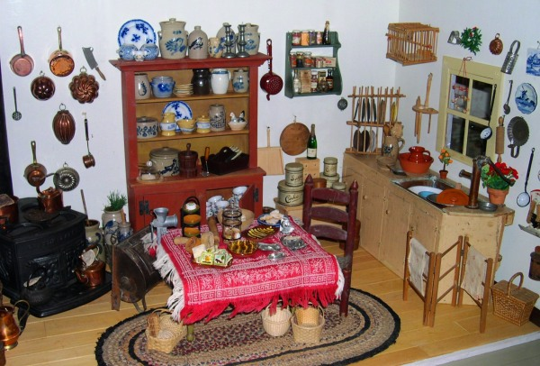 The kitchen of the Tasha Tudor Dollhouse at Colonial Williamsburg, December 2004 -- A perfect example of fitting small things into small spaces!
