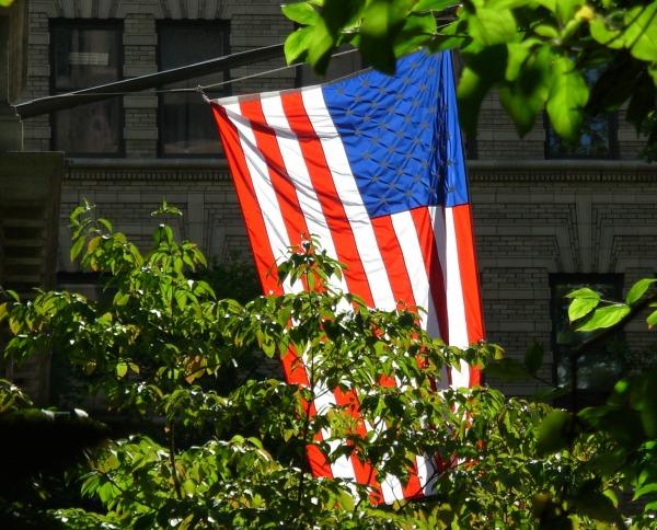 The sun lights an American flag in Boston, September 2007