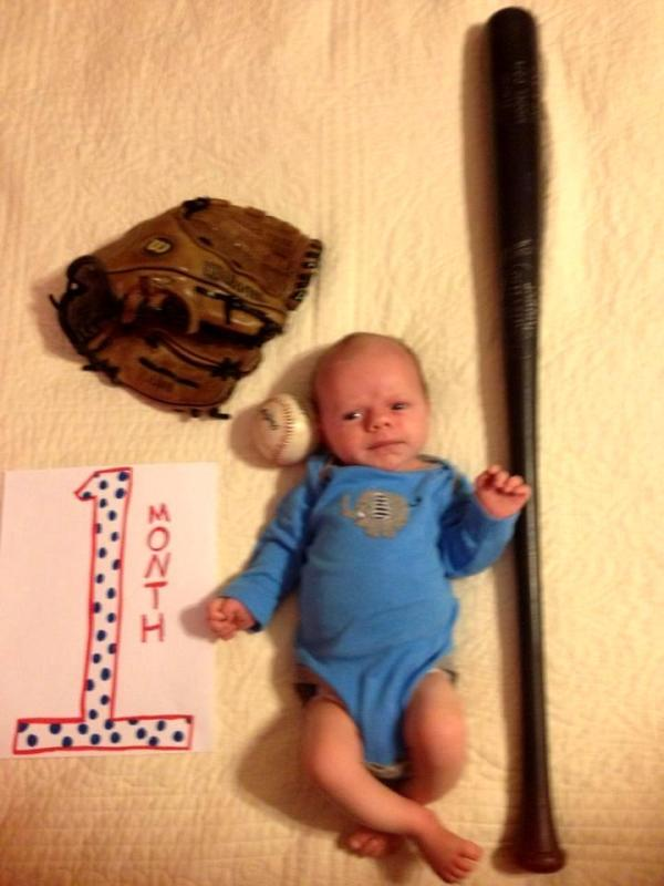 "This is Drew's idea of a 1-month portrait.  This guy is SERIOUS about baseball.  Grady looks as if he is thinking, ""Whatever baseball is, I hope I like it or I'm TOAST."""