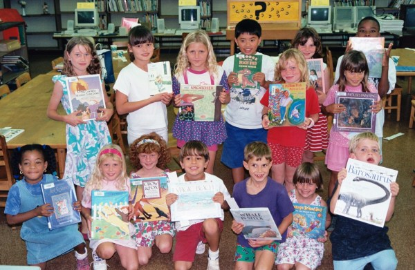 Students in my school library book club show their favorites. Honolulu, Hawaii, 1995