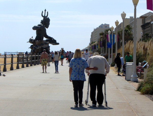 Strolling past Poseidon on the boardwalk, Virginia Beach, September 2013.