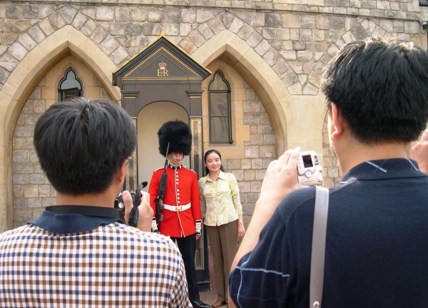 One of many tourists who pose with the Queen's Guard.  Windsor Castle, August 2005