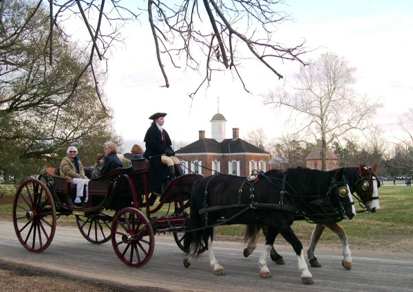 William Durant preferred carriages, but took another road and changed history. Visitors enjoy a December evening at Colonial Williamsburg, 2004