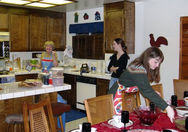 Janet and her daughters prepare yet another Christmas Eve dinner, 2002