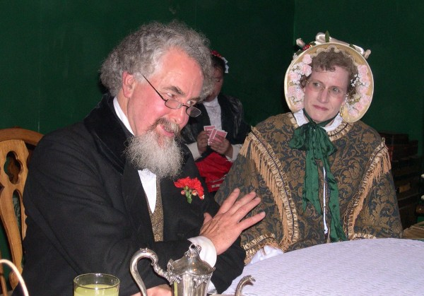 Charles Dickens reads Stave I of A Christmas Carol to enthralled listeners at the Green Man Inn. The Dickens Fair, San Francisco, December 2003