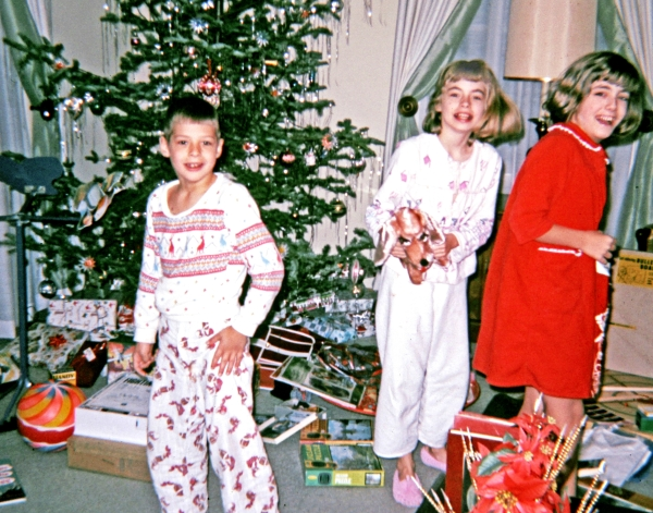 Al, Carla and me on Christmas morning, sometime in the mid-1960s.