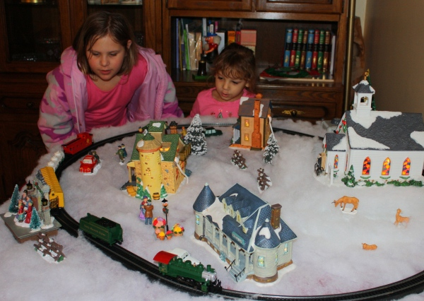 Visiting friends enjoy Tammy's train set, December 2009.