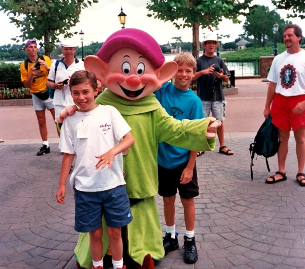 We might call him Dopey, but at least he's getting paid to be there. And he's not waiting in any lines, either.  Disney World, summer 1995