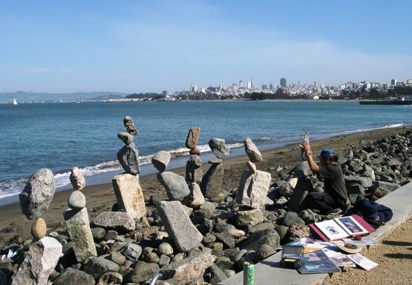 This man had as much fun balancing rocks as we had watching him!  San Francisco, February 2003