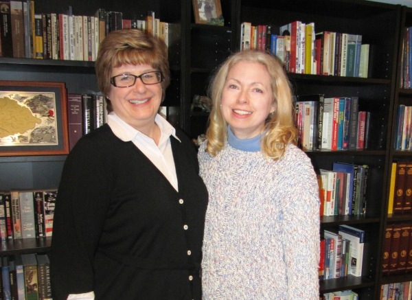 Amy and me with a teeny-tiny section of her family's BOOKS!  February 2012