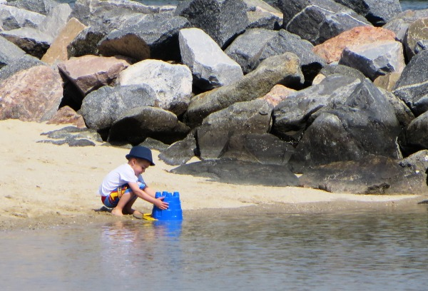 This young boy was too busy to notice I was taking photos of him as he worked. On the beach at Yorktown, Virginia, March 2014