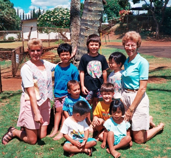 Peggy (right) her instructional assistant and preschool class in Oahu, Hawaii, 1996 (Yes, people really did go barefoot at school sometimes, or at least used to!)