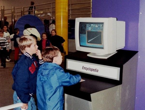 Drew and Matt explore a computer encyclopedia at Science World, Vancouver, BC, 1993