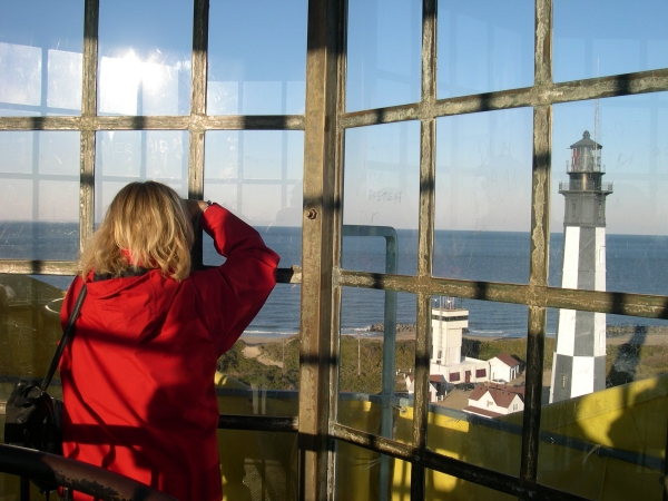 Looking out from one lighthouse to another.   Kathy photographs the newer lighthouse from the older one,  Cape Henry Virginia, April 2009.