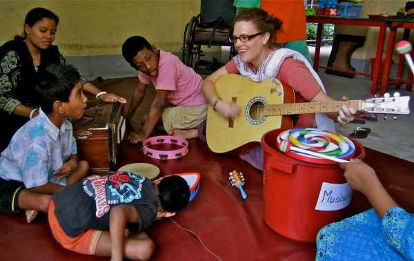 Australian volunteer Kylie Hinde at the Center for Disability in Development, Bangladesh, 2011. Photo by Australian Department of Foreign Affairs and Trade via Wikimedia Commons, CC-BY-2.0