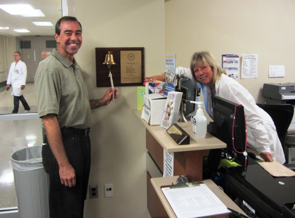 """Jeff participates in the traditional ritual of """"ringing out"""" on his last day of radiation at Walter Reed, September 2013."""