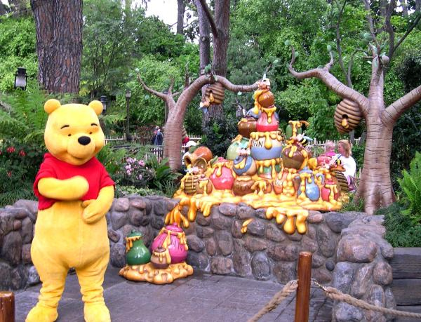 """Just thinking about """"hunny"""" makes Pooh happy! Disneyland, Anaheim, CA, April 2003"""