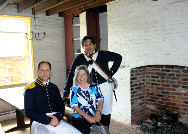 Carla poses with soldiers from the War of 1812, Ft. McHenry, Baltimore MD, August 2010.