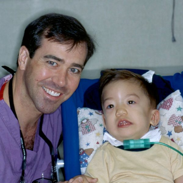 Jeff with one of his youngest patients, San Antonio, Texas, 1996
