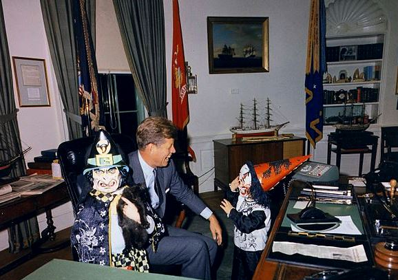 Even the President is not too busy for some Halloween fun.  October 31, 1963 Image in the public domain, via Wikimedia Commons