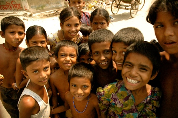Crowd of smiling children in Bangladesh, via Wikimedia Commons