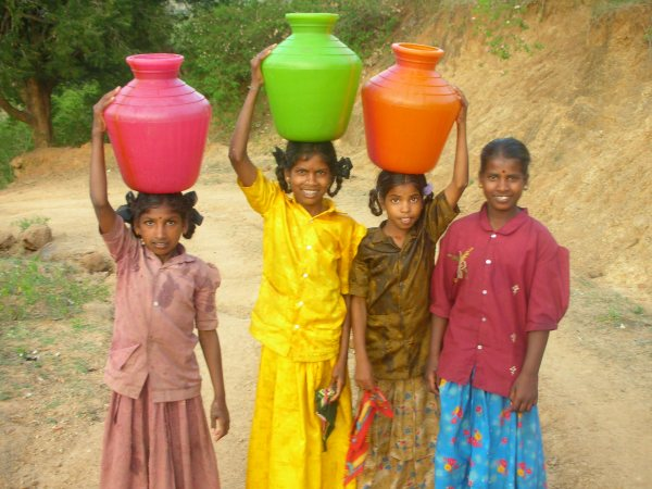 Girls carrying water in India, via Wikimedia Commons