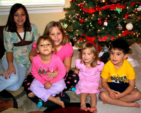 Our friends' children under the Christmas tree at Tammy and JJ's home, December 2009.