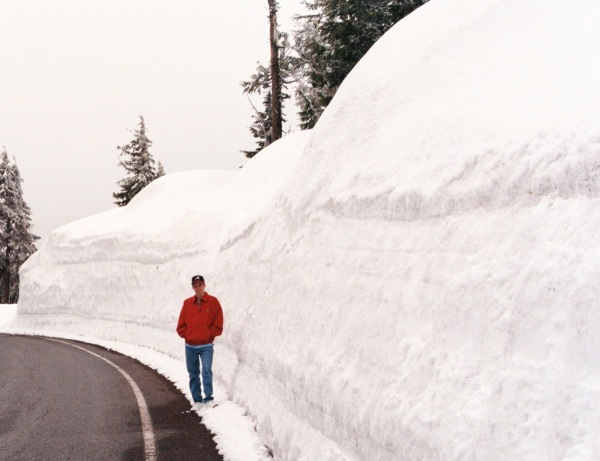 Snow to shovel?  Remember, it could be worse!  This is Drew at Crater Lake, Oregon, in June (yes, June) 2000.