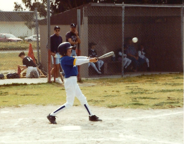 Eight-year-old Drew, during his first year of playing baseball. He hit a lot more triples than homeruns -- no wonder I like triples!