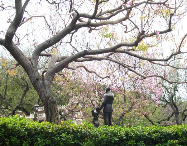 A statue of Walt Disney and Mickey Mouse stands in the park they built together. Disneyland, California, April 2003