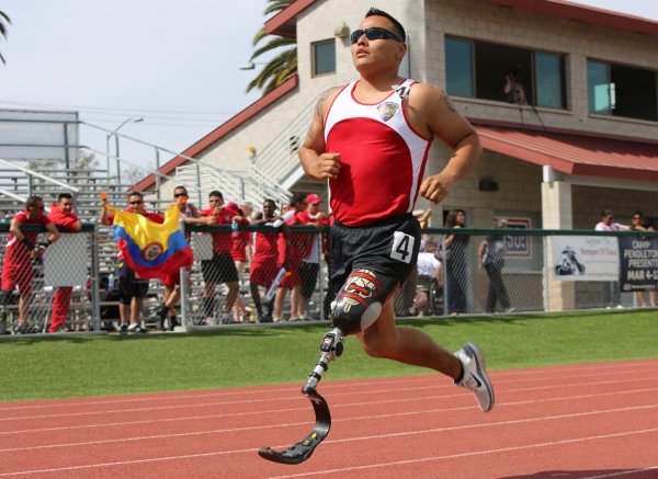 Not passive: Cpl. Marcus Chischilly's patient training pays off at the 2014 Marine Corps Trials, Camp Pendleton, California. Public domain photo by Lance Cpl. John Baker via Wikimedia Commons