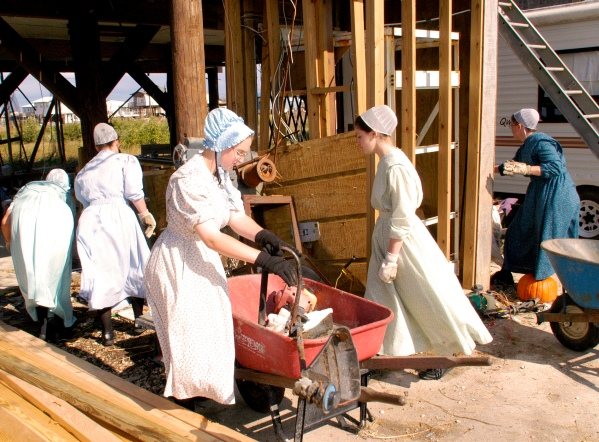 Mennonite sisters from Maryland go after Hurricane Katrina relief with all sorts of tools. Photo by Marvin Nauman, from the FEMA Photo Library,public domain via Wikimedia Commons